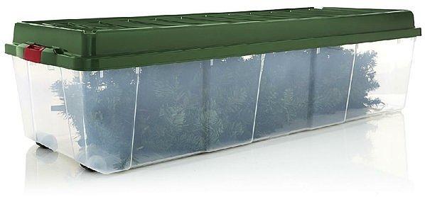 Контейнер для хранения искусственной ели должен быть просторным. На дно укладывается ствол, затем подставка, а сверху — ветви.