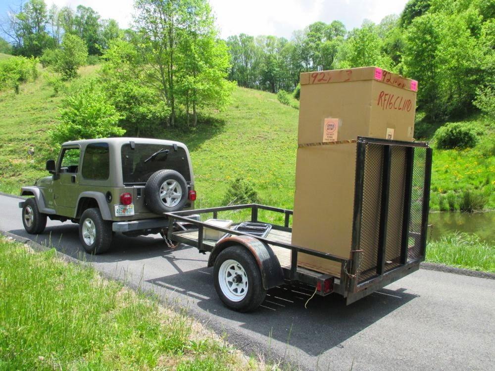 Автоприцеп с упором для фиксации — безопасная доставка холодильника